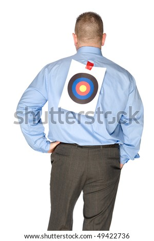 A businessman with a bulls eye that someone taped onto his shirt.