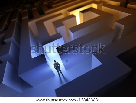 A businessman with a challenge / maze ahead of him. - stock photo