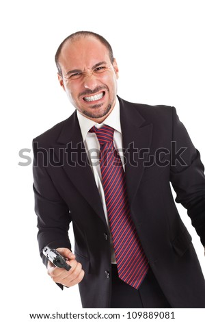 a businessman with a gun expressing anger - stock photo