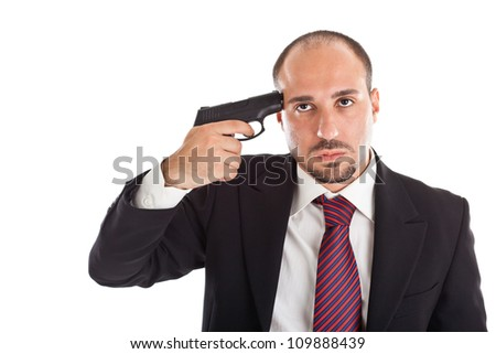 A businessman with a handgun committing suicide - stock photo