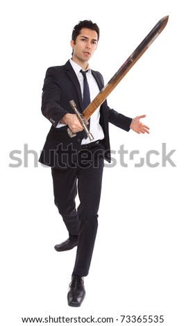 A businessman with a long sword in attacking stance - stock photo