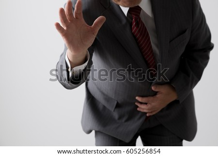 A businessman with a stomachache, a middle aged man
