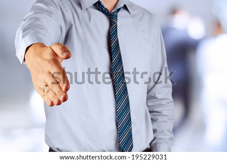 A businessman with an open hand ready to seal a deal - stock photo