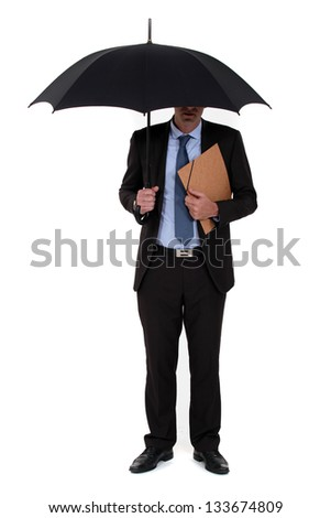 A businessman with an umbrella. - stock photo