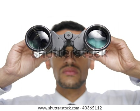 A businessman with binoculars isolated on white. - stock photo