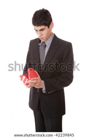 a businessman with heart shaped gift