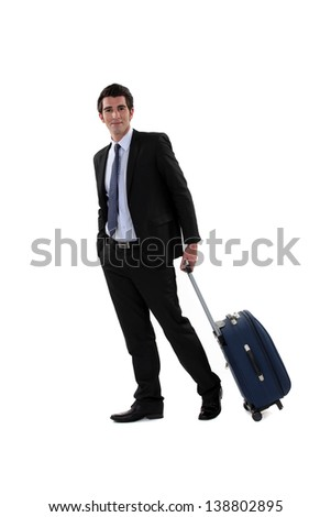 A businessman with his luggage. - stock photo
