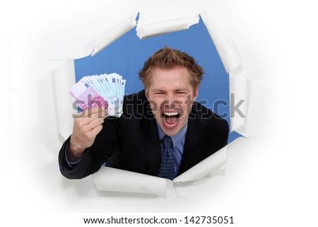 A businessman with plenty of cash. - stock photo