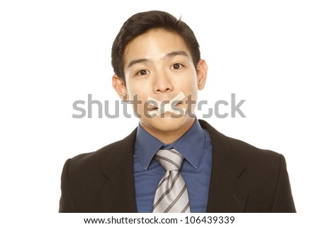A businessman with tape over his mouth (isolated on white) - stock photo