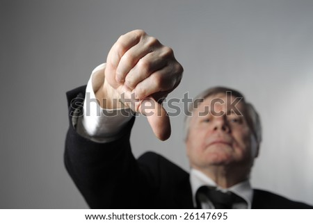 a businessman with thumbs down