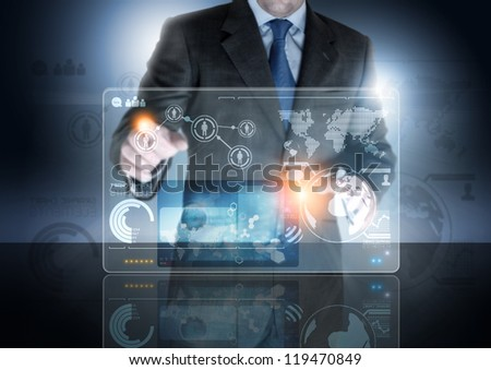 A businessman working on a communication Device. - stock photo