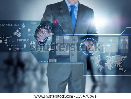 A businessman working on a touch screen. - stock photo