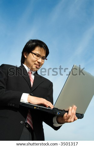 A businessman working on his laptop outdoor
