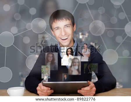 A businessman working on modern technology tablet computer and communicating with social media networking. Sharing photo, connecting people? chatting with partners - stock photo