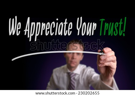 A businessman writing We Appreciate Your Trust on a screen. Business Concept. - stock photo
