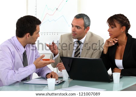 A businessteam working on a project. - stock photo