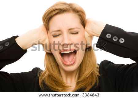 A Businesswoman covers her ears with emotion - stock photo