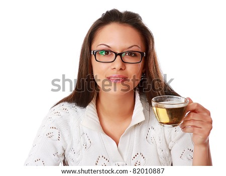 A businesswoman drinking green tea, isolated on white, close-up
