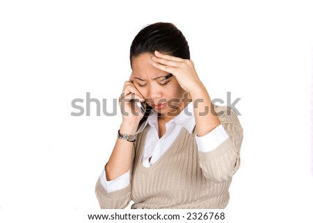 A businesswoman feeling despair as she listens to the news over the mobile phone, isolated on white. - stock photo