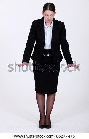 A businesswoman gesturing. - stock photo