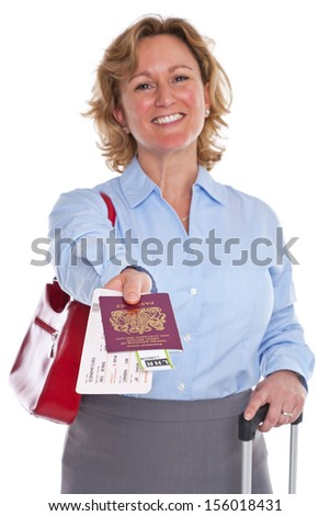 A businesswoman handing over her passport and flight tickets, isolated against a white background. The tickets are mock ups and all details are fake. - stock photo