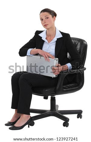 A businesswoman holding a case - stock photo