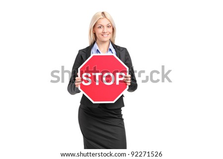 A businesswoman holding a traffic sign stop isolated on white background - stock photo