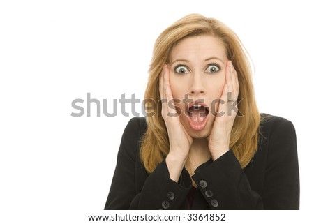 A businesswoman in a suit gestures surprise - stock photo
