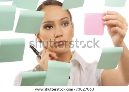 A businesswoman looking at stickers - stock photo