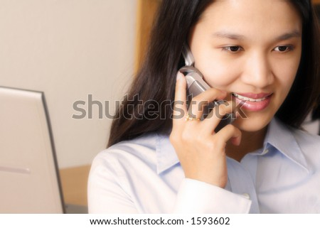 A businesswoman making a phone call