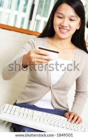 A businesswoman making an online purchase