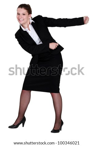 A businesswoman miming. - stock photo