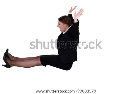 A businesswoman on a edge. - stock photo