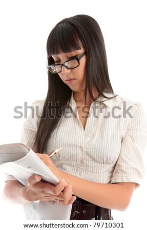 A businesswoman reading the financial section,  employment section or other section of a newspaper. - stock photo