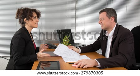A businesswoman signing a contract - business concept - stock photo