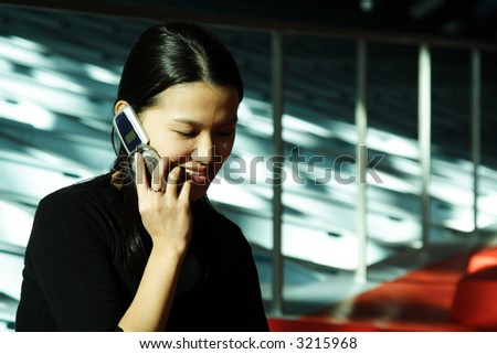 A businesswoman talking on a cell phone - stock photo