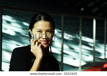 A businesswoman talking on a cell phone
