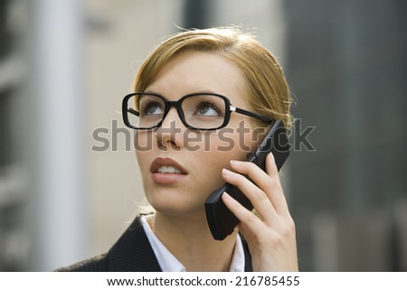 A businesswoman talking on her phone. - stock photo