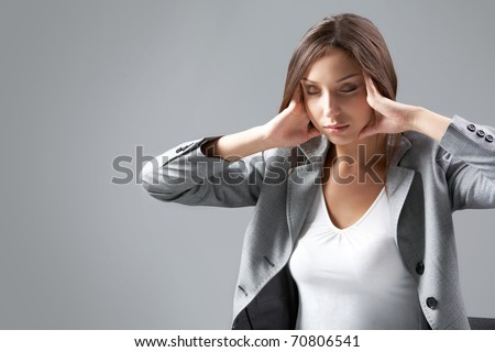 A businesswoman trying to relax her eyes - stock photo