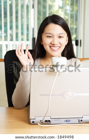 A businesswoman using webcam for meeting - stock photo
