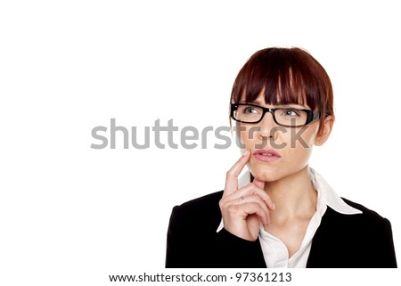 A businesswoman wearing a black business suit is thinking up new ideas. Thinking businesswoman. - stock photo