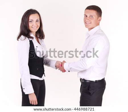 A businesswoman welcoming a new employee to the company. Multi-ethnic business team.