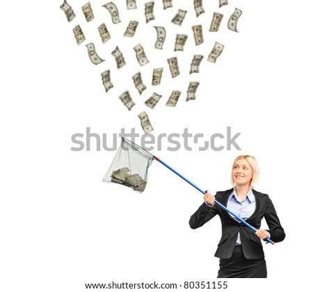 A businesswoman with a  net trying to catch money isolated on white background - stock photo