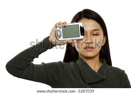 A businesswoman with a PDA covering her right eye