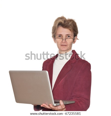 A businesswoman with glasses and laptop isolated on white.