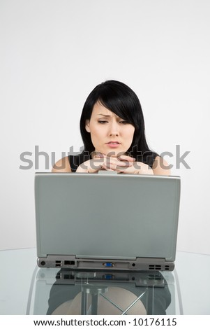 A businesswoman working on her laptop at her office