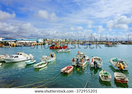 A busy beautiful summer day in the historic fishing harbor of Lagos, The Algarve, Portugal - stock photo