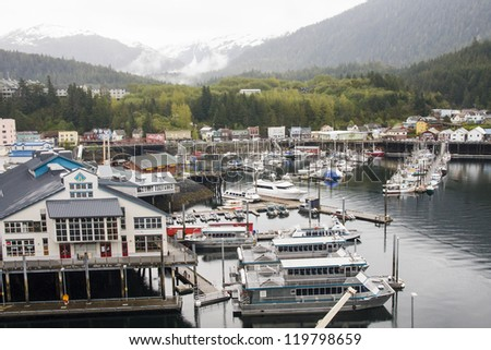 A busy harbor in Ketchikan, Alaska full of yachts, fishing boats and sailboats - stock photo