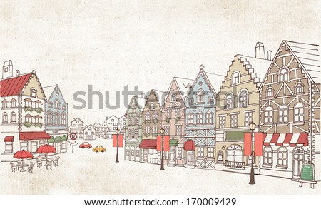 A busy street with many houses and cars. - stock photo