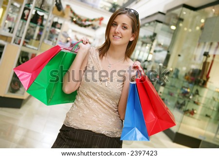 A busy woman shopping for the holidays - stock photo